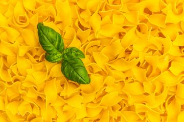 tagliatelle noodels texture with basil leaf- Stock Photo or Stock Video of rcfotostock | RC-Photo-Stock