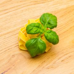 tagliatelle pasta nest with basil leaf- Stock Photo or Stock Video of rcfotostock | RC-Photo-Stock