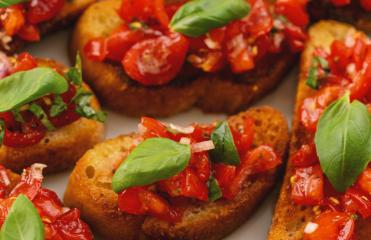 Tasty savory tomato Italian appetizers, or bruschetta, on slices of toasted baguette garnished with basil : Stock Photo or Stock Video Download rcfotostock photos, images and assets rcfotostock | RC-Photo-Stock.:
