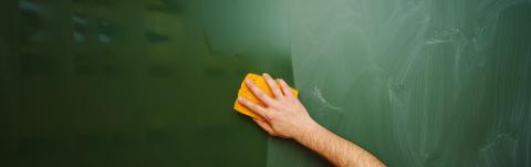 Teacher Hand cleaning dirty green chalkboard with sponge, blackboard texture background with copy space, banner size- Stock Photo or Stock Video of rcfotostock | RC-Photo-Stock
