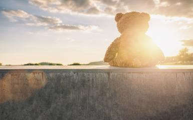 teddy bear sitting on a stone wall at sunset with cloudy sky, rear view. Love theme. Concept about love and relationship. copyspace for your individual text.- Stock Photo or Stock Video of rcfotostock | RC-Photo-Stock