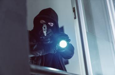 Terrorist or a Burglar pointing with a gun outside a window at night : Stock Photo or Stock Video Download rcfotostock photos, images and assets rcfotostock | RC-Photo-Stock.: