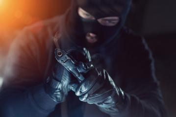 Terrorist or a thief holding a gun at night : Stock Photo or Stock Video Download rcfotostock photos, images and assets rcfotostock | RC-Photo-Stock.: