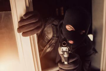 Terrorist or a thief pointing a gun in to a House : Stock Photo or Stock Video Download rcfotostock photos, images and assets rcfotostock | RC-Photo-Stock.: