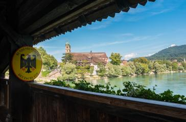 The border to Germany at the historic wooden bridge and Fridolins minster in Bad Saeckingen at summer, Black Forest, Baden-Wurttemberg, Germany, Europe- Stock Photo or Stock Video of rcfotostock | RC-Photo-Stock