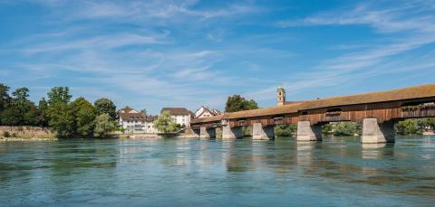 The historic wood border bridge over Rhine river and Fridolins minster in Bad Saeckingen at summer, Black Forest, Baden-Wurttemberg, Germany, Europe : Stock Photo or Stock Video Download rcfotostock photos, images and assets rcfotostock | RC-Photo-Stock.: