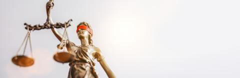 The Statue of Justice - lady justice or Iustitia / Justitia the Roman goddess of Justice with red blindfold, banner size, copyspace for your individual text.- Stock Photo or Stock Video of rcfotostock | RC-Photo-Stock