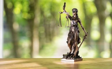 The Statue of Justice symbol in a lawyer offfice, including copy space, legal law concept image : Stock Photo or Stock Video Download rcfotostock photos, images and assets rcfotostock | RC-Photo-Stock.:
