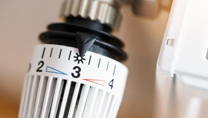 thermostatic radiator valve set to middle temperature, symbol for saving money at heating costs- Stock Photo or Stock Video of rcfotostock | RC-Photo-Stock