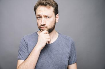 thoughtful man who looks away touching his chin and weighs the pluses and minuses of the offer- Stock Photo or Stock Video of rcfotostock | RC-Photo-Stock