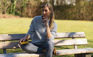 thoughtful woman sitting in the park on at a bench. student thinking with a book in the park concept image : Stock Photo or Stock Video Download rcfotostock photos, images and assets rcfotostock | RC-Photo-Stock.: