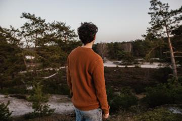 Thoughtful young man looks at the beautiful nature. People are future-oriented and positive thinking in the forest.- Stock Photo or Stock Video of rcfotostock | RC-Photo-Stock