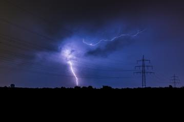 thunderbolt impact next to a Electricity pylon : Stock Photo or Stock Video Download rcfotostock photos, images and assets rcfotostock | RC-Photo-Stock.: