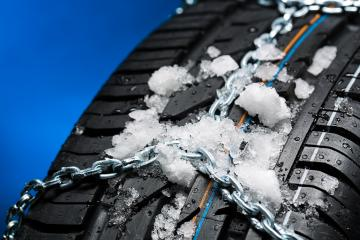 Tire with ice and snow chain  : Stock Photo or Stock Video Download rcfotostock photos, images and assets rcfotostock | RC-Photo-Stock.: