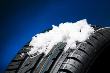 Tire with snow heap at the winter on blue blackground : Stock Photo or Stock Video Download rcfotostock photos, images and assets rcfotostock | RC-Photo-Stock.: