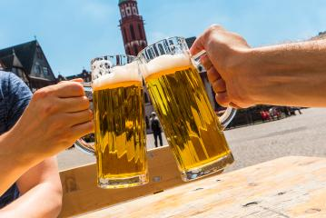 toast with glasses of german beer at the beer garden- Stock Photo or Stock Video of rcfotostock | RC-Photo-Stock