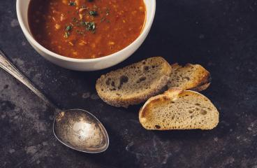 tomato soup with basil and baguette in a ceramic bowl on a dark background. Healthy eating concept - Stock Photo or Stock Video of rcfotostock | RC-Photo-Stock