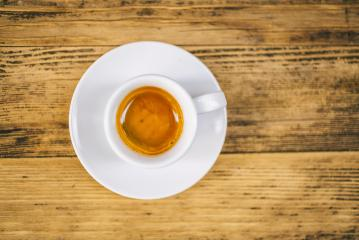 top view a cup of espresso coffee on wooden table background- Stock Photo or Stock Video of rcfotostock | RC-Photo-Stock