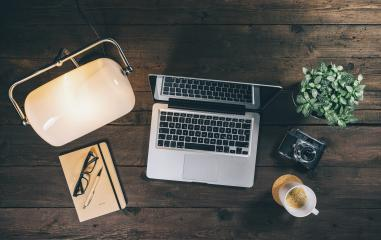 Top view of a hipster workdesk or home office with Laptop or Notebook, lamp, coffee cup and vinatge camera. New Business concept image- Stock Photo or Stock Video of rcfotostock | RC-Photo-Stock
