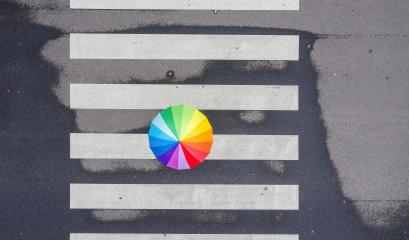 Top view of a rainbow umbrella on a pedestrian crosswalk : Stock Photo or Stock Video Download rcfotostock photos, images and assets rcfotostock | RC-Photo-Stock.: