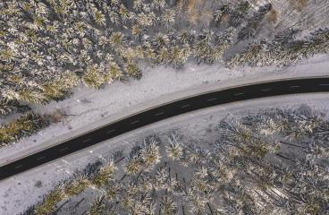 Top view of winter forest and Road at sunset- Stock Photo or Stock Video of rcfotostock | RC-Photo-Stock