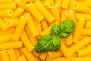 Tortiglioni Noodles background with basil leaf- Stock Photo or Stock Video of rcfotostock | RC-Photo-Stock