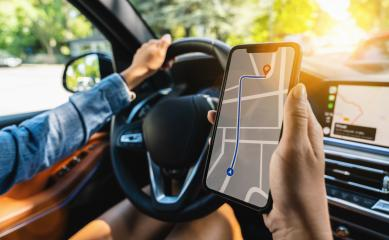 Tourist using GPS map navigation app on smartphone screen to get direction to destination address in the car, travel and technology concept image- Stock Photo or Stock Video of rcfotostock   RC-Photo-Stock