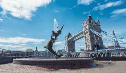 Tower Bridge and St Katharine Docks Girl with a dolpin fountain, London, UK- Stock Photo or Stock Video of rcfotostock | RC-Photo-Stock