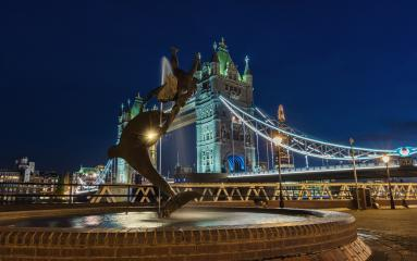 Tower Bridge and statue of a dolphin with girl playing at night in London. : Stock Photo or Stock Video Download rcfotostock photos, images and assets rcfotostock | RC-Photo-Stock.: