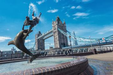 Tower Bridge and statue of a girl playing with dolphin in St Katharine docks in London.- Stock Photo or Stock Video of rcfotostock | RC-Photo-Stock
