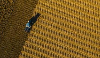 tractor ploughing a field. Industrial background on agricultural theme. Use drones to inspect of your business. - Stock Photo or Stock Video of rcfotostock | RC-Photo-Stock