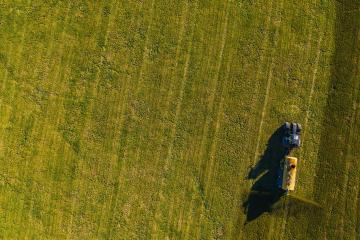 tractor sprays its manure from the tanker onto a field. Industrial background on agricultural theme. Use drones to inspect of your business.- Stock Photo or Stock Video of rcfotostock | RC-Photo-Stock
