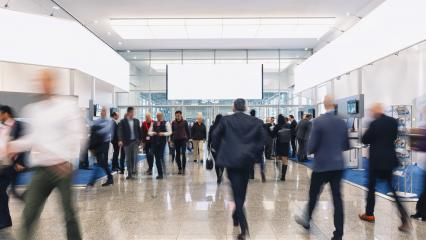 trade fair visitors walking in a clean futuristic corridor, copy space for individual text - Stock Photo or Stock Video of rcfotostock | RC-Photo-Stock