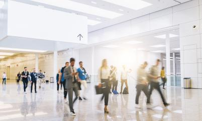 trade fair visitors walking in a clean futuristic corridor with banner for copy space- Stock Photo or Stock Video of rcfotostock | RC-Photo-Stock