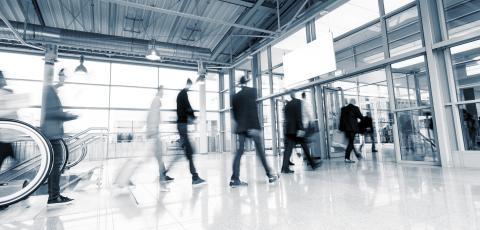 Tradeshow Visitors walking in a modern hall- Stock Photo or Stock Video of rcfotostock | RC-Photo-Stock