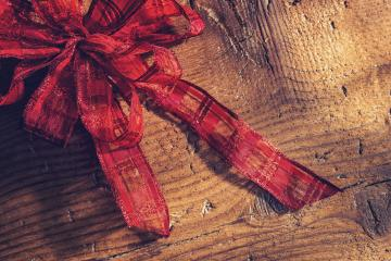 traditional christmas bow on wooden background- Stock Photo or Stock Video of rcfotostock | RC-Photo-Stock