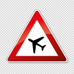 Traffic sign airport. German road warning sign: Low flying airplanes on checked transparent background. Vector illustration. Eps 10 vector file.- Stock Photo or Stock Video of rcfotostock | RC-Photo-Stock