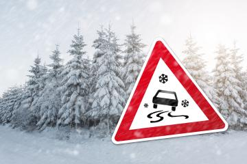 traffic sign for winter time with black ice and snow on the street and a winter forest : Stock Photo or Stock Video Download rcfotostock photos, images and assets rcfotostock | RC-Photo-Stock.: