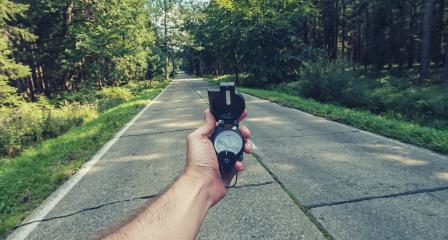 Travel Concept man hand hold Compass on the road in the outback. Point of view shot - Stock Photo or Stock Video of rcfotostock | RC-Photo-Stock