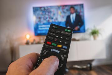 TV remote control, the hand with a remote control, pov view- Stock Photo or Stock Video of rcfotostock | RC-Photo-Stock