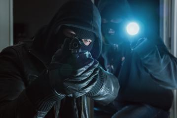 Two Burglar trying to break into a house with a Gun : Stock Photo or Stock Video Download rcfotostock photos, images and assets rcfotostock | RC-Photo-Stock.: