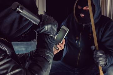 Two burglar use smartphone for a Housebreak : Stock Photo or Stock Video Download rcfotostock photos, images and assets rcfotostock | RC-Photo-Stock.: