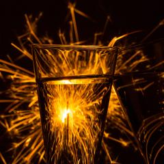Two glasses of champagne with fireworks sparklers- Stock Photo or Stock Video of rcfotostock | RC-Photo-Stock