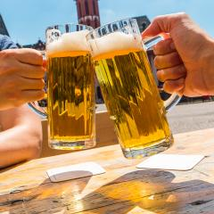 Two hands clinking beer glasses at summer- Stock Photo or Stock Video of rcfotostock | RC-Photo-Stock