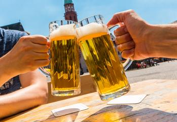 two human hands toast with glasses of german beer in Frankfurt- Stock Photo or Stock Video of rcfotostock | RC-Photo-Stock