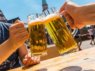 two mans holding beer mug at a beer garden in germany- Stock Photo or Stock Video of rcfotostock | RC-Photo-Stock