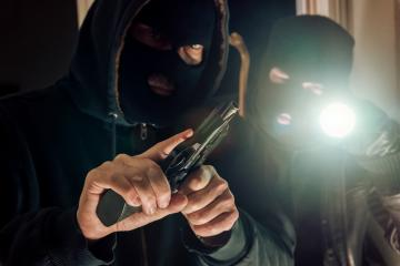 Two masked Burglar with gun and flashlight breaking in a house : Stock Photo or Stock Video Download rcfotostock photos, images and assets rcfotostock | RC-Photo-Stock.: