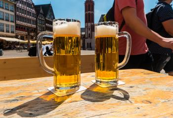 Two mugs of beer on table at Frankfurt in germany- Stock Photo or Stock Video of rcfotostock | RC-Photo-Stock