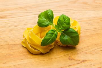 two pasta noodle nests with basil- Stock Photo or Stock Video of rcfotostock | RC-Photo-Stock