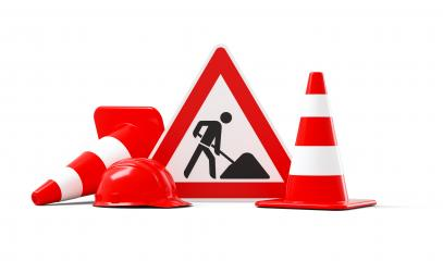 Under construction, road sign, traffic cones and red safety helmet, isolated on white background. 3D rendering- Stock Photo or Stock Video of rcfotostock | RC-Photo-Stock